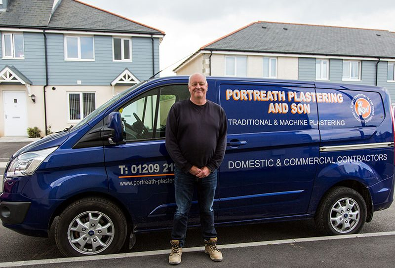 Portreath Plastering van with the owner of the company stood next to it.